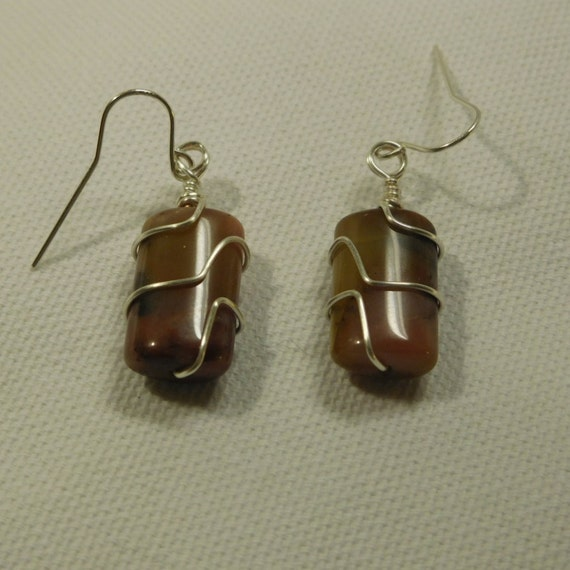 Wire wrapped stone dangle earrings. Silver wire and carmal colored stone. Barrel shaped drop earrings.