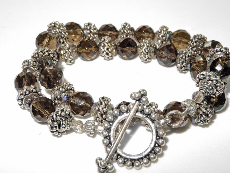 Silver from Bali 16  Necklace Smokey topaz colored quartz with integral locking silver beads A nice oversized toggle is a good finish.