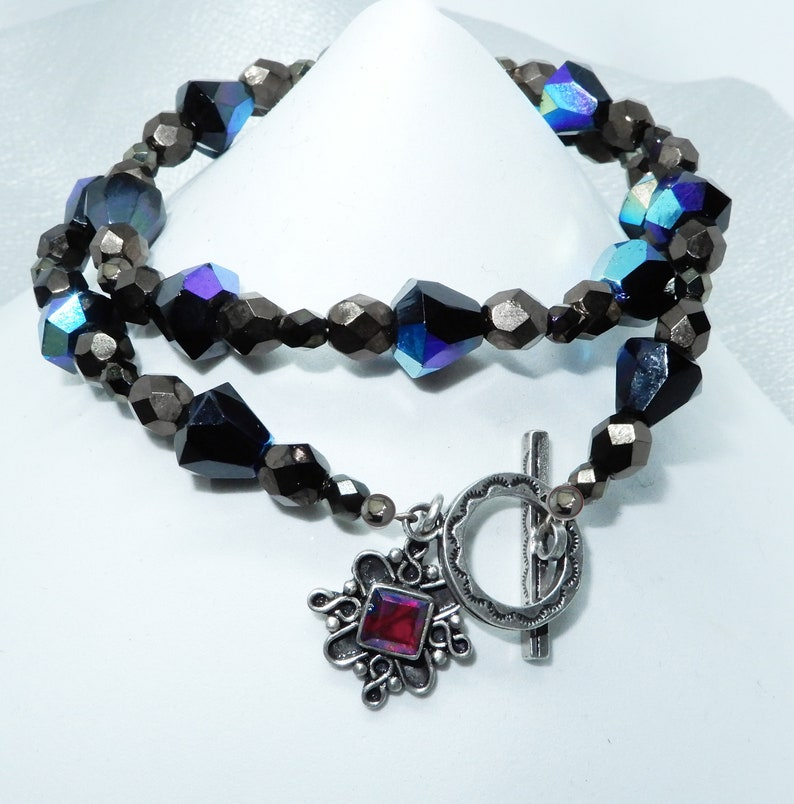 Czech glass and Bali Silver with garnet accent and a with sterling toggle. 16 inch choker necklace