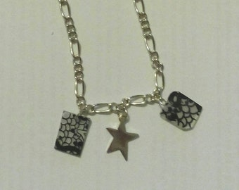 Chain bracelet with metal charms and shrink plastic