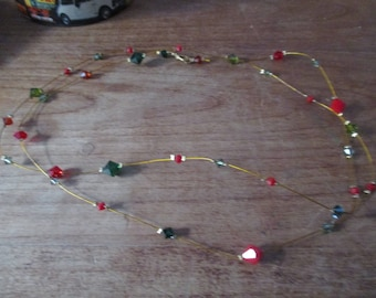 Red, green diamont pearl necklace.