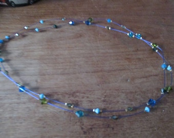Blue, green diamont pearl necklace.