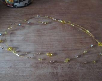 Yellow diamond pearl necklace.