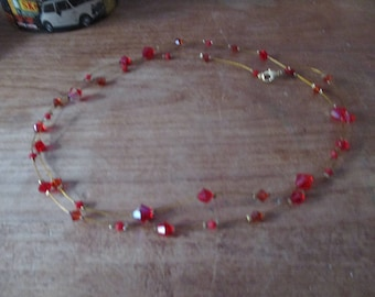 Red diamont pearl necklace.