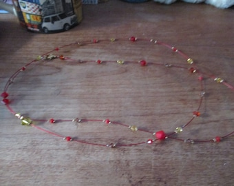 Red, yellow diamont pearl necklace.