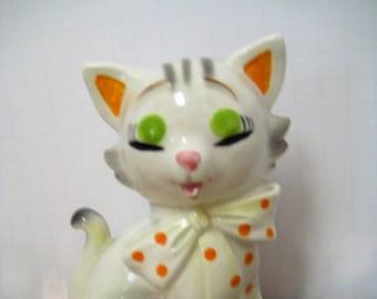 Kitty Bank or 'Eye Shadow Reminder Kitty.'