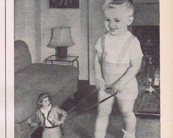 Johnson's Baby Oil and Powder 1947 Old Ad with Weird Giant Baby Picture