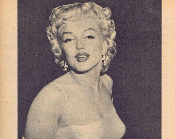 Marilyn Monroe 1956 classic sexy pose picture with her news and events