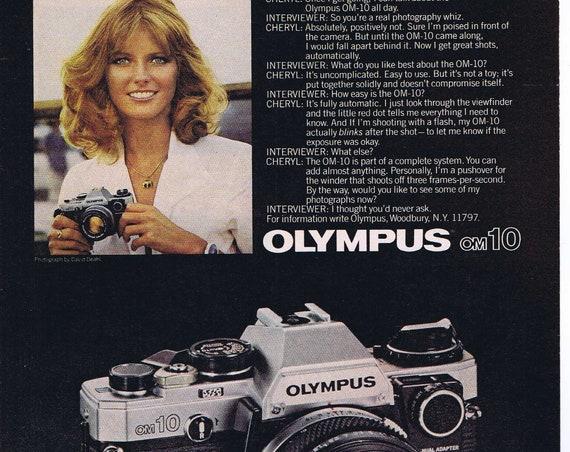 1980 Cheryl Tiegs and Olypus OM-10 Camera or Chevrolet Monte Carlo Original Advertisement