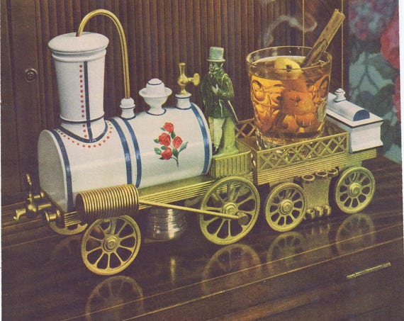 1944 Four Roses Whiskey with Hot Toddy Antique Locomotive Original Vintage Advertisement