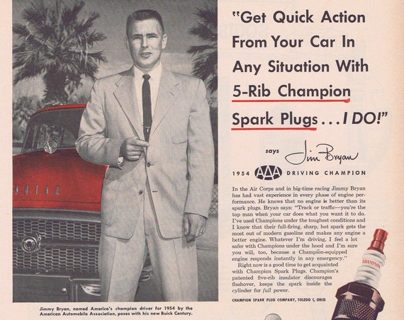 1956 Race Driver Jimmy Bryan for Champion Spark Plugs Original Vintage Advertisement Poses with new Buick Century