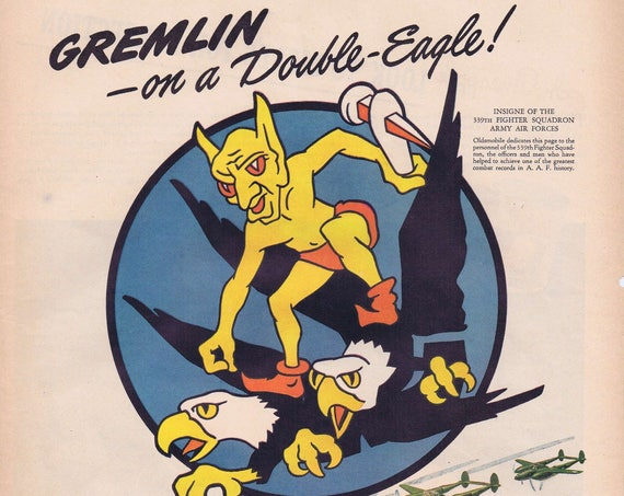 1943 WW2 Gremlin on a Double Eagle Insignia of the 339th Squadron Army Air Forces Original Vintage Advertisement by Oldsmobile