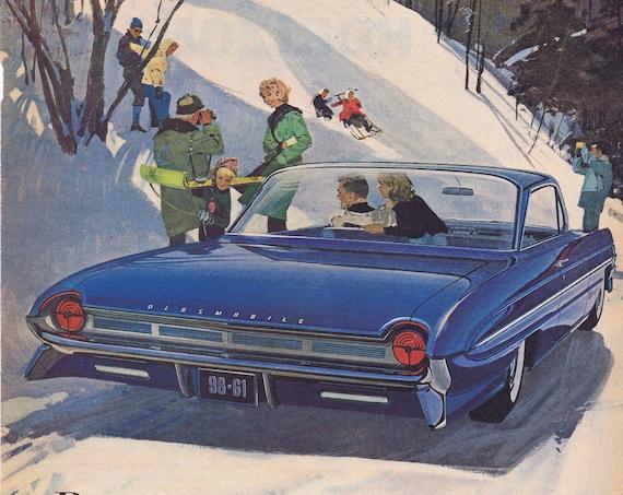 1961 Beautiful Oldsmobile with Skyrocket Performance Original Vintage Advertisement in Nice Winter Scene