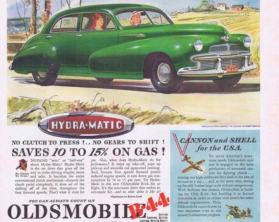 1942 Oldsmobile Green Sedan Automobile or Gas Fuel for the Home Original Vintage Advertisements