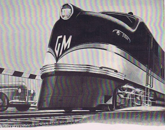 1941 General Motors Locomotive Train WWII Era Original Advertisement