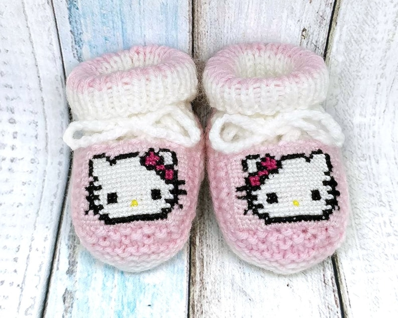 1ec742a058e89 Hello Kitty knitted baby booties, baby girl booties,girl knitted baby  booties, Hello Kitty crib shoes, pregnancy announcement, baby reveal