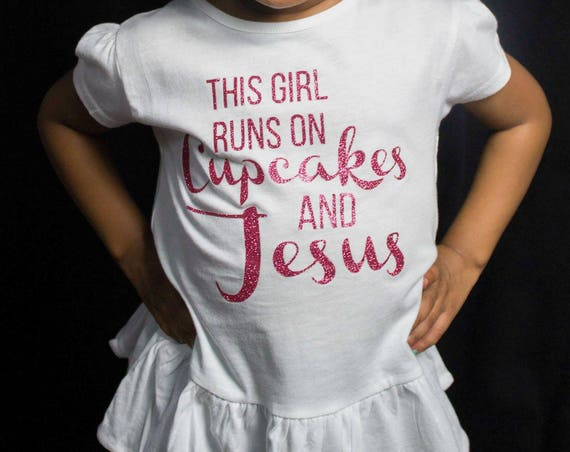 This Girl Runs On Cupcakes & Jesus, Toddler, Little Girls Ruffle Tee in 5 Colors in Sizes 2T-Girls Large