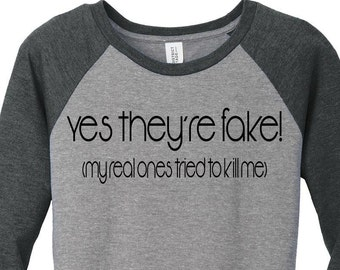 Yes They're Are Fake, My Real Ones Tried To Kill Me Breast Cancer Baseball Raglan 2 Tone 3/4 Sleeve Womens Tops in Sizes Small-4X, Plus Size
