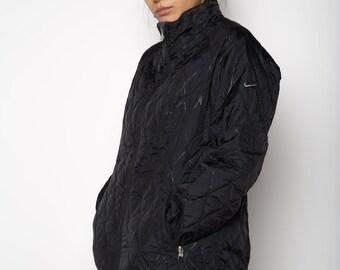 931b3d6e575e Berlin Black NIKE Puffer Jacket L