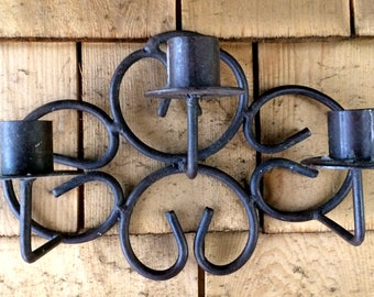 Wall Candle Holders A pair Decorative Swirling Iron Wall Sconces each wrought iron holder holds three candles