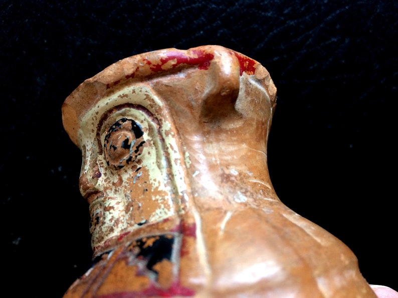 Early Aztec Mayan looking pottery holding a head fascinating glaze Kinda Gruesome
