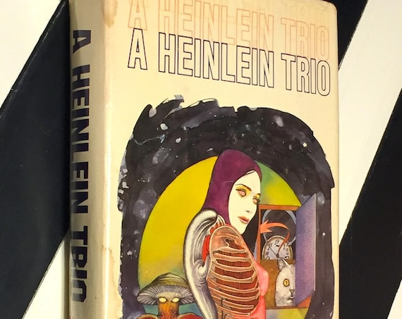 A Heinlein Trio by Robert Heinlein (1957) hardcover book