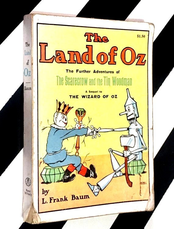 The Land of Oz: The Further Adventures of The Scarecrow and the Tin Woodman by L. Frank Baum (reprint) softcover book
