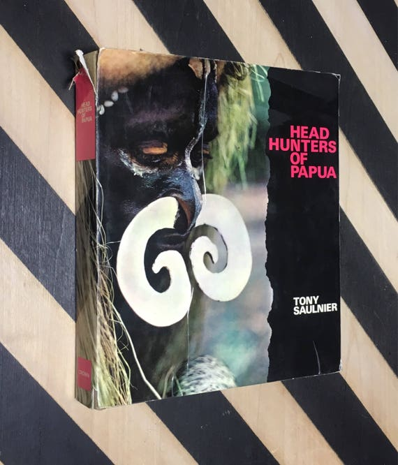 Head Hunters of Papua by Tony Sauliner with the collaboration of Marcel Bisiaux; Translation by Margaret Shenfield (1963) hardcover book