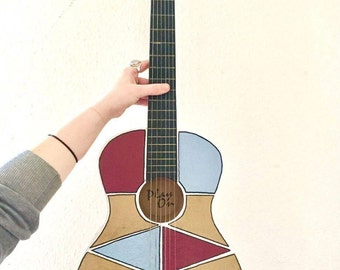 Hand painted classic guitar with a unique and bold design.