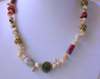 Necklace with coral, porcelain and brass chips, 46 cm