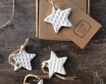 Handmade Ceramic white star ornament with daisy design. Christmas gift tags, decorations, wedding, favours. Made with white clay