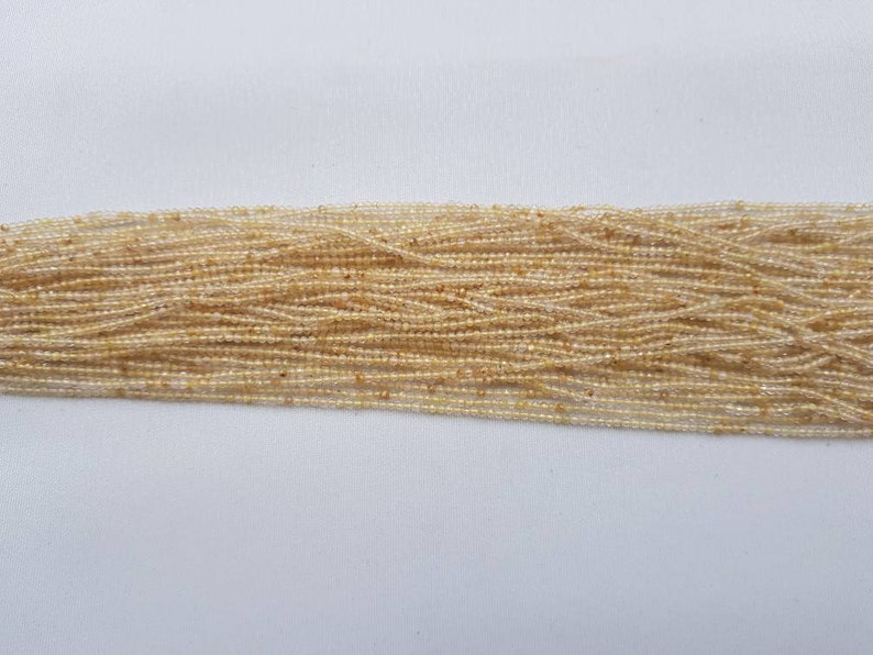 3 strands of Yellow Rutile round faceted beads 2mm size 12.5 each.
