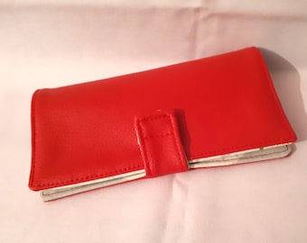 Fabric checkbook and red faux leather