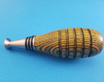 Hand turned yellow laminated wood, with Ruth Niles Bottle Stopper
