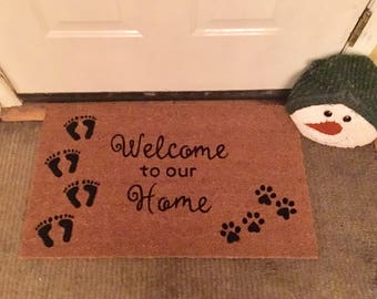 Superior Welcome To Our Home Foot Prints And Paw Prints Door Mat ...