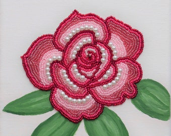 Red and pink rose embroidery on painted canvas