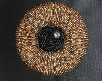 Eye of the Beholder - bead embroidery on black canvas