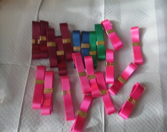Lot of 20 bundles of ribbon 4 colors - pink, burgandy, blue, and green.  Unmarked