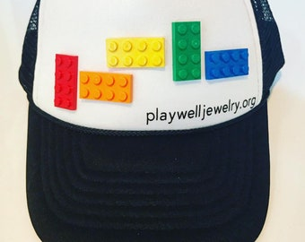 Play Well Trucker Hat