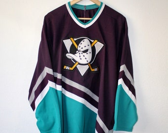 c4b16a4823b Vintage 90s Anaheim Mighty Ducks CCM Hockey Jersey Size Large Disney Era  Purple Teal OG Throwback