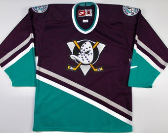 6d0c17b8a71 Vintage 90s Original Anaheim Mighty Ducks Nike Hockey NHL Jersey Size  Medium Disney Era OG throwback