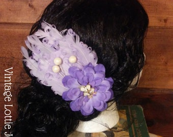 Lavendar feather and flower fascinator