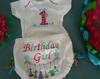 Adorable first birthday onsie, really cute with the multi colored tutu!