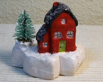 Tiny Christmas House sculpted from sturdy artist's cement.