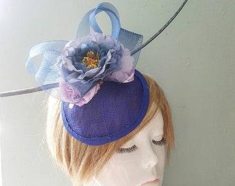 Blue Peonie Roses Lilac Rose Bud Navy Sinamay Swirl & Statement Feather Spine Royal Blue Circular Mini Hat Fascinator