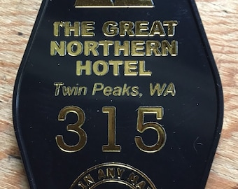 """Black with gold lettered Twin Peaks Inspired """"GREAT NORTHERN HOTEL keychain"""
