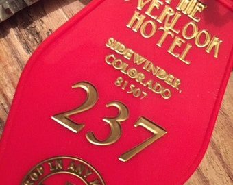 Red with gold printed THE SHINING inspired OVERLOOK '237' Hotel Keytag