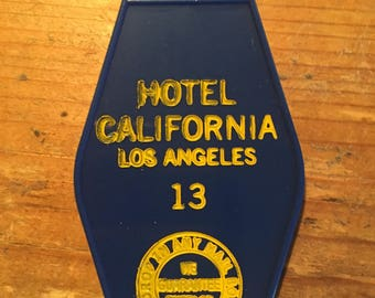 Blue with yellow print The HOTEL CALIFORNIA keytag