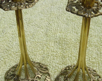 a pair of vintage lattice work brass candle sticks