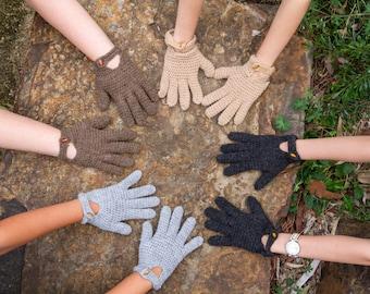 Hand knitted woollen alpaca gloves with a wooden detail
